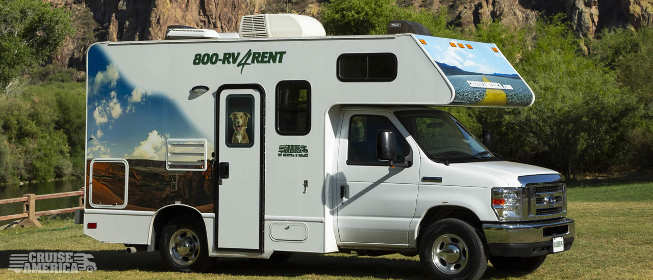 Front view of compact RV, showing side with door.