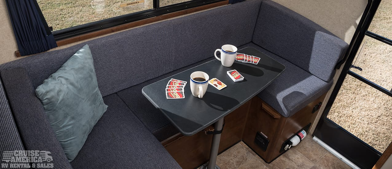 Dinette table that seats three, behind driver's seat.